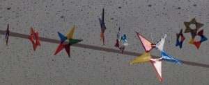 Glass stars hanging in the Glenfair library.