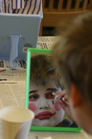 A student puts on his clown face as part of an Albert Alter in-school residency.