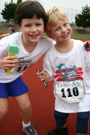 A couple of young runners cool off after the 2013 Kids Dash.