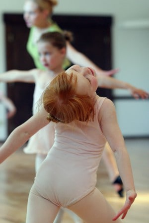 A young student of Rachel's rehearses at the Maple Valley School of Ballet.