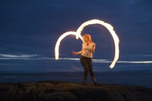 In her not-so-secret other life, Rachel is also a professional fire performer. Photo credit: Tim Summers